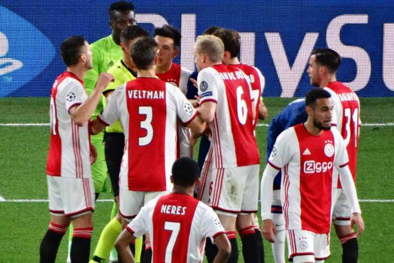 Ajax players protesting after two red cards
